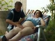 Hot pregnant lady relaxes in nature